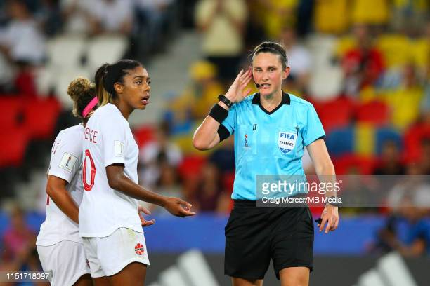 Referee Kate Jacewicz consults her assistants during a VAR review during the 2019 FIFA Women's World Cup France Round Of 16 match between Sweden and...