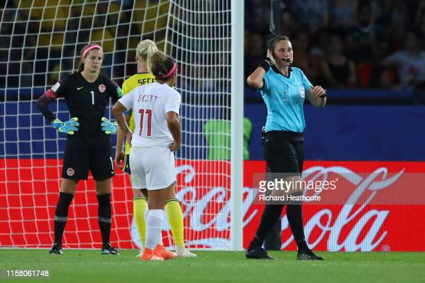 Referee Kate Jacewicz indicates she is going to use VAR after awarding Sweden a penalty during the 2019 FIFA Women's World Cup France Round Of 16...
