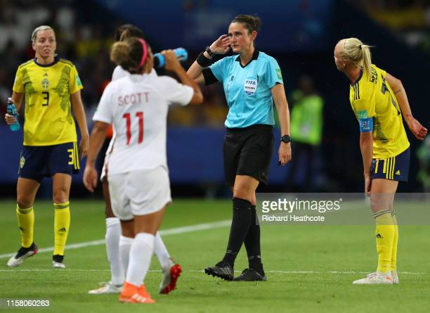 Referee Kate Jacewicz listens to a VAR review during the 2019 FIFA Women's World Cup France Round Of 16 match between Sweden and Canada at Parc des...