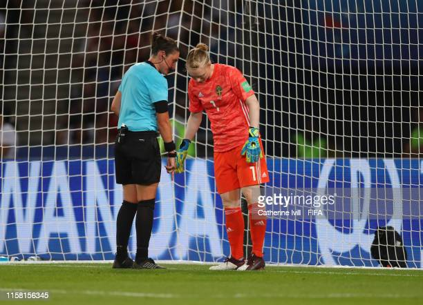 Referee Kate Jacewicz points to the line as she talks to goalkeeper Hedvig Lindahl of Sweden before a penalty during the 2019 FIFA Women's World Cup...
