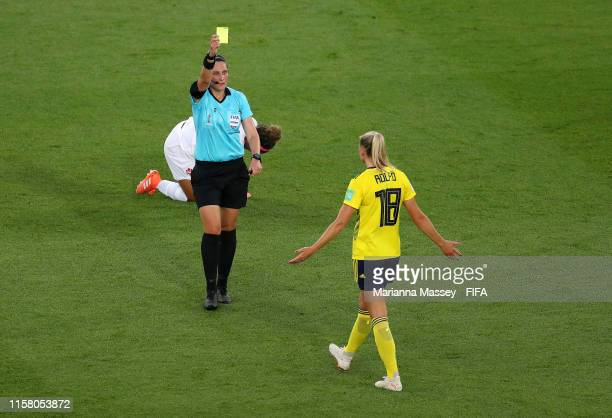 Referee Kate Jacewicz shows a yellow card to Fridolina Rolfo of Sweden during the 2019 FIFA Women's World Cup France Round Of 16 match between Sweden...