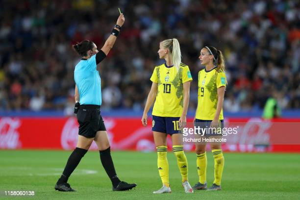Referee Kate Jacewicz shows Kosovare Asllani of Sweden a yellow card during the 2019 FIFA Women's World Cup France Round Of 16 match between Sweden...