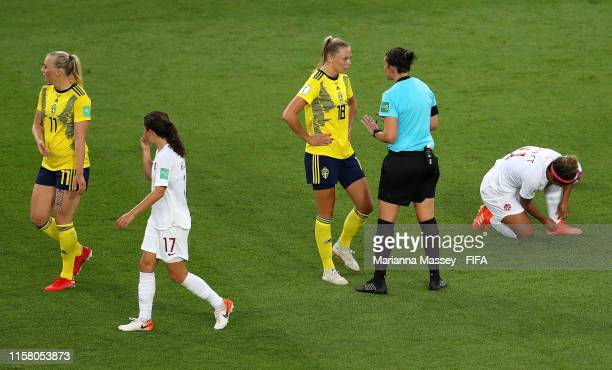 Referee Kate Jacewicz speaks with Fridolina Rolfo of Sweden during the 2019 FIFA Women's World Cup France Round Of 16 match between Sweden and Canada...