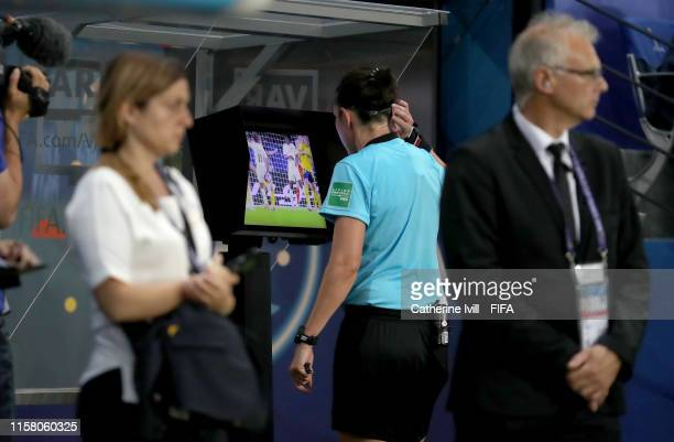 Referee Kate Jacewicz takes part in a VAR review during the 2019 FIFA Women's World Cup France Round Of 16 match between Sweden and Canada at Parc...