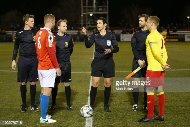 Referee Kate Jacewicz tosses the coin before the FFA Cup round of 32 match between Canberra FC v Broadmeadow Magic at Deakin Stadium on July 25, 2018...