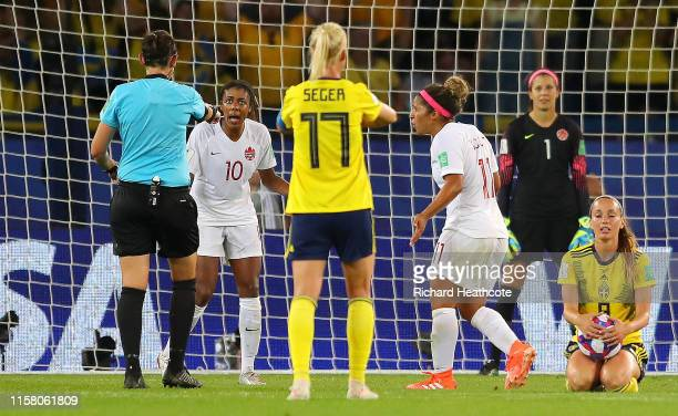 Referee Kate Jacewiz awards Swedena a penalty after Fridolina Rolfo of Sweden is fouled inside the penalty area by Ashley Lawrence of Canada but the...