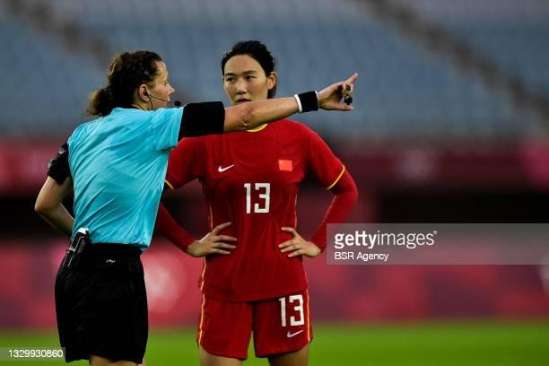 Referee Kateryna Monzul of Ukraine and Lina Yang of China during the Tokyo 2020 Olympic Football Tournament match between China and Brazil at Miyagi...