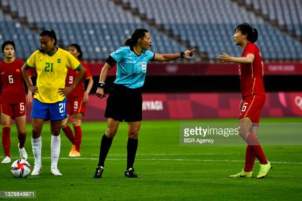 Referee Kateryna Monzul of Ukraine and Xiaoxue Wang of China during the Tokyo 2020 Olympic Football Tournament match between China and Brazil at...