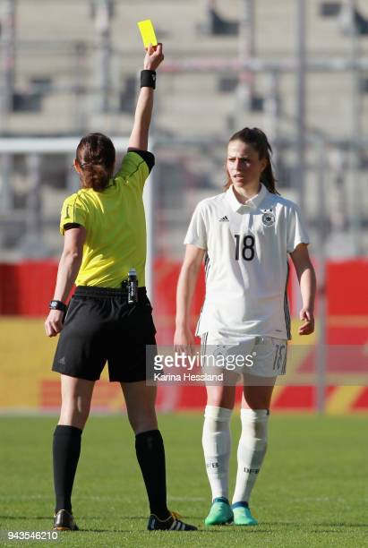 Referee Kateryna Monzul shows the yellow card to Melanie Leupolz of Germany during the 2019 FIFA Womens World Championship Qualifier match between...