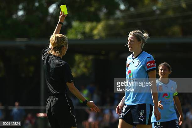 Referee Katie Patterson shows Alanna Kennedy of Sydney FC a yellow card during the round eight WLeague match between Sydney FC and the Western Sydney...