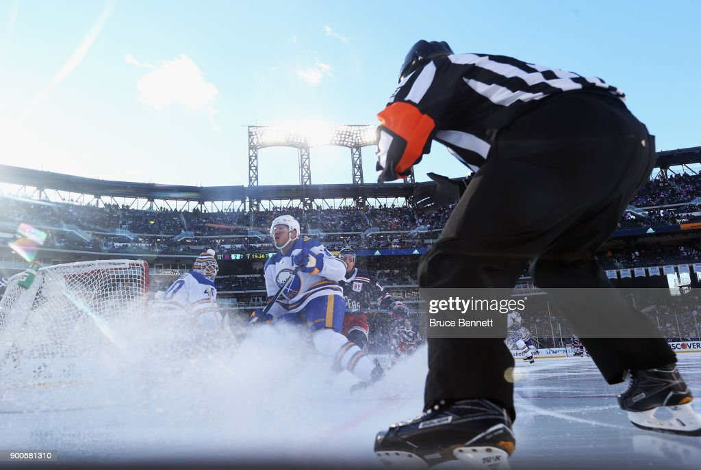 A referee keeps his eyes on the action between the Buffalo Sabres and the New York Rangers during the 2018 Bridgestone NHL Winter Classic at Citi Field on January 1, 2018 in Flushing neighborhood of the Queens borough of New York City, New York. The Rangers defeated the Sabres 3-2 in overtime.