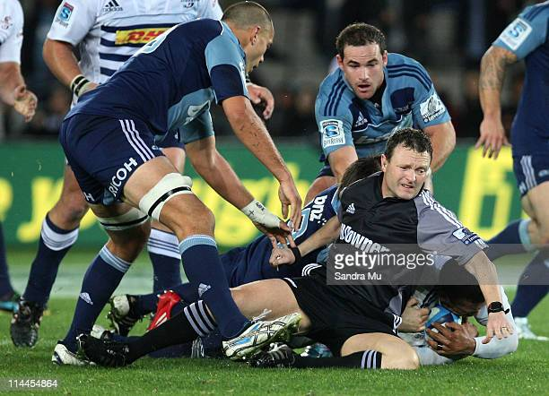 Referee Keith Brown is taken down in a tackle during the round 14 Super Rugby match between the Blues and the Stormers at Eden Park on May 20 2011 in...
