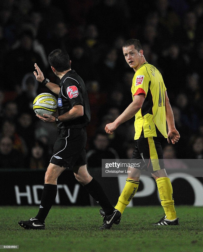 Referee Keith Stroud asks Heider Helguson of Watford to leave the field after he clashes heads in a tackle during the Coca-Cola Championship match between Watford and Derby County at Vicarage Road on December 12, 2009 in Watford, England.