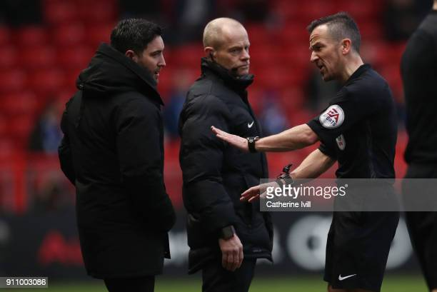 Referee Keith Stroud has words with Bristol City manager Lee Johnson during the Sky Bet Championship match between Bristol City and Queens Park...