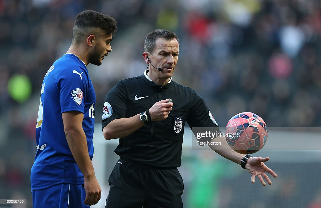 Referee Keith Stroud restarts the game with a drop ball as Sam Morsy of Chesterfield looks on during the FA Cup Second Round match between MK Dons and Chesterfield at Stadium mk on December 6, 2014 in Milton Keynes, England.