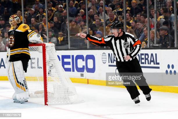 Referee Kelly Sutherland calls a penalty during Game 7 of the 2019 First Round Stanley Cup Playoffs between the Boston Bruins and the Toronto Maple...