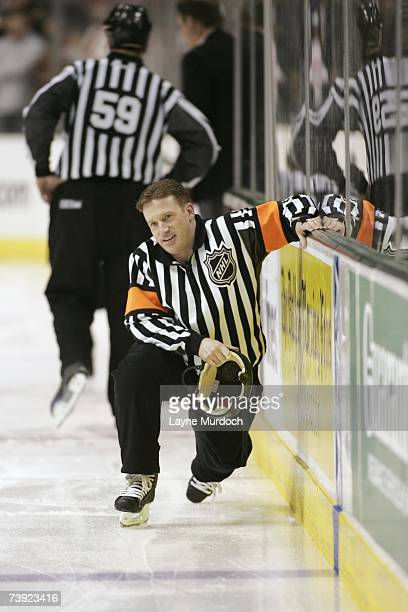 Referee Kelly Sutherland gets up from the ice during game three of the 2007 NHL Western Conference Quarterfinals between the Vancouver Canucks...