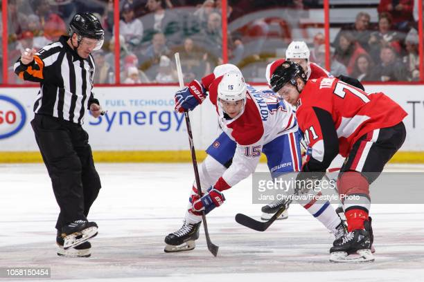 Referee Kelly Sutherland reacts to a face-off between Chris Tierney the Ottawa Senators and Jesperi Kotkaniemi of the Montreal Canadiens at Canadian...