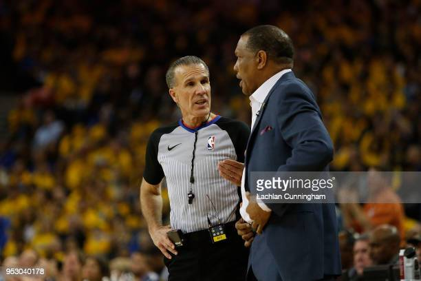 Referee Ken Mauer speaks with with New Orleans Pelicans head coach Alvin Gentry during Game One of the Western Conference Semifinals at ORACLE Arena...