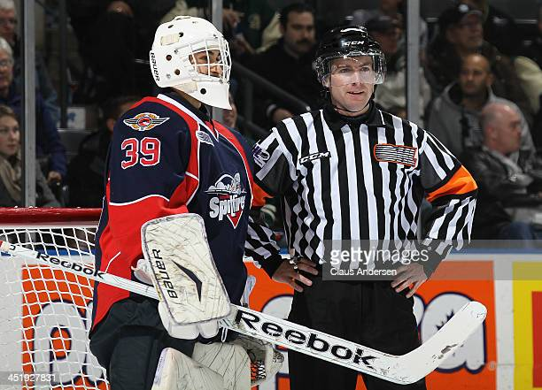 Referee Kendrick Nicholson chats with Alex Fotinos of the Windsor Spitfires during stoppage in an OHL game against the London Knights at the...