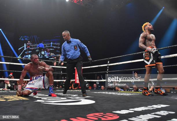 Referee Kenny Bayless delivers a count to Erislandy Lara as Jarrett Hurd heads to a neutral corner during their WBA/IBF junior middleweight...