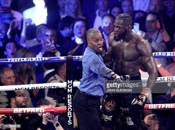 Referee Kenny Bayless directs US boxer Deontay Wilder to his corner after stopping his World Boxing Council Heavyweight Championship Title boxing...