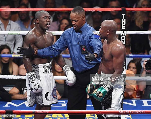 Referee Kenny Bayless separates Andre Berto and Floyd Mayweather Jr during the seventh round of their WBC/WBA welterweight title fight at MGM Grand...