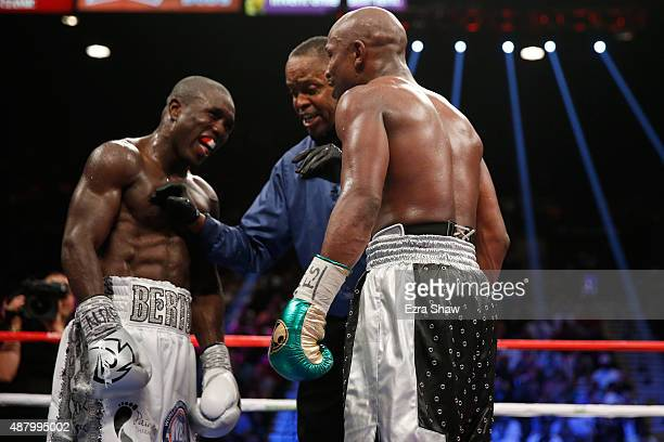 Referee Kenny Bayless stops the fight to admonish Floyd Mayweather Jr and Andre Berto for verbal exchanges during their WBC/WBA welterweight title...