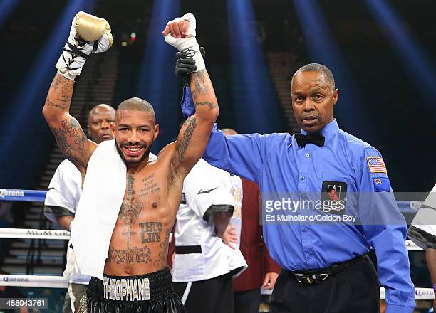 Referee Kenny Bayliss raises the arm of Ashley Theophane after his knockout win over Angino Perez during their welterweight fight at the MGM Grand...