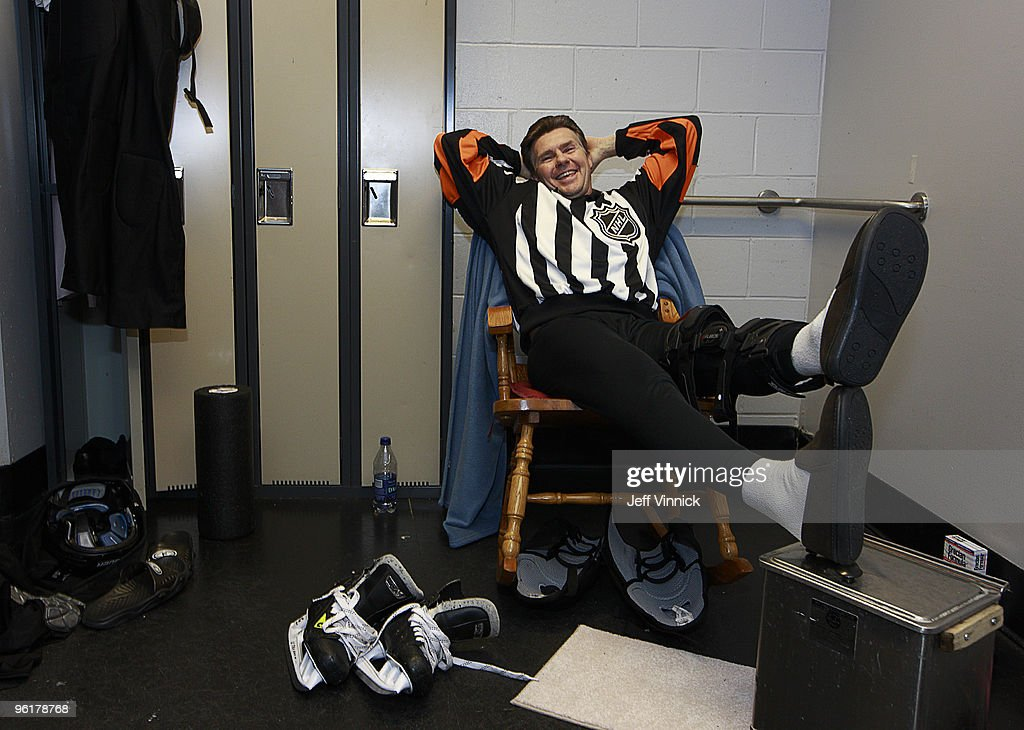 Referee Kerry Fraser relaxes in a rocking chair in his dressing room before the game between the Vancouver Canucks and the Buffalo Sabres at General Motors Place on January 25, 2010 in Vancouver, British Columbia, Canada. Fraser was given a rocking chair from the off ice officials as a gift to commemorate his last game refereeing in Vancouver.