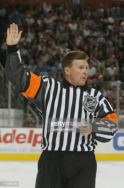 Referee Kerry Fraser signals in game four of the Eastern Conference Semifinals between the Buffalo Sabres and the Ottawa Senators during the 2006 NHL...