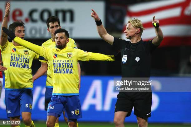 Referee Kevin Blom changes his mind after speaking on his radio and mircophone via video evidence during the Dutch KNVB Cup Semifinal match between...