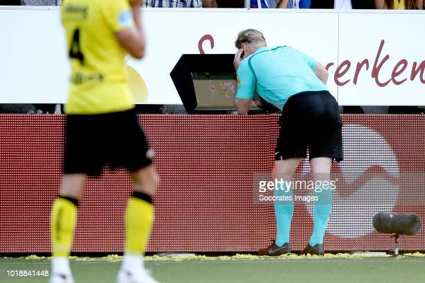 referee Kevin Blom looks at the Video assistant referee VAR screen during the Dutch Eredivisie match between VVVvVenlo Ajax at the Seacon Stadium De...