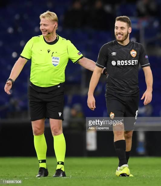 Referee Kevin Blom smiles as Nikola Vlasic of CSKA Moskva celebrates scoring his team's first goal during the UEFA Europa League group H match...