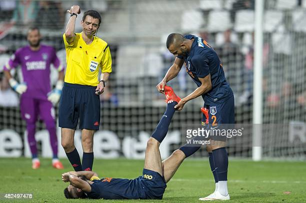 Referee Kevin Clancy, Mahmud Tekdemir of Istanbul Basaksehir, Yalcin Ayhan of Istanbul Basaksehir during the Europa league third qualifying round...