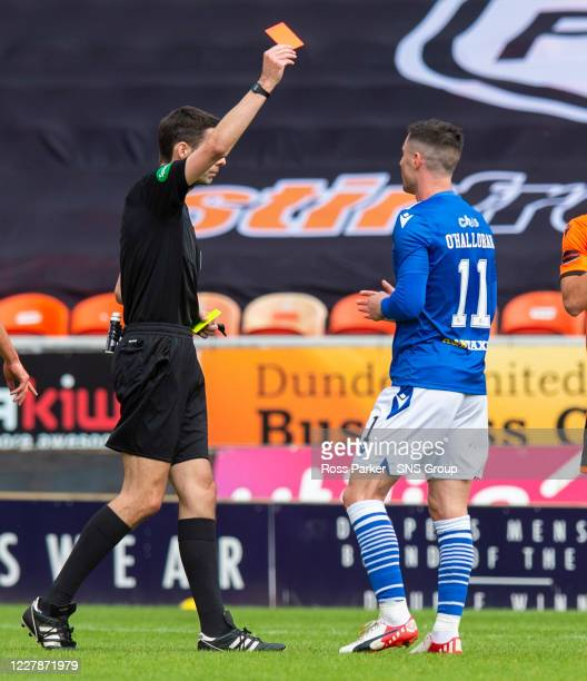 Referee Kevin Clancy sends off Michael O'Halloran during the Scottish Premiership match between Dundee United and St Johnstone at Tannadice Park on...