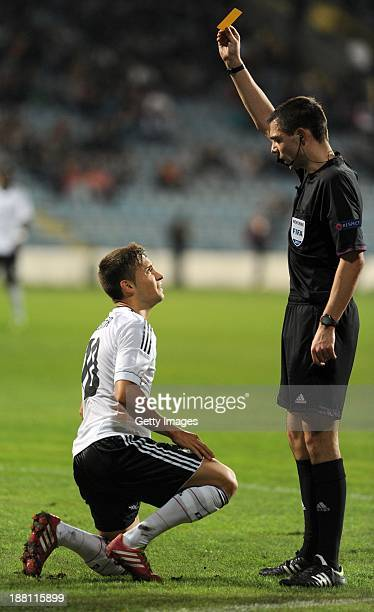 Referee Kevin Clancy shows the yellow card to Moritz Leitner of Germany during the UEFA Under21 European Championships Qualifier between U21...