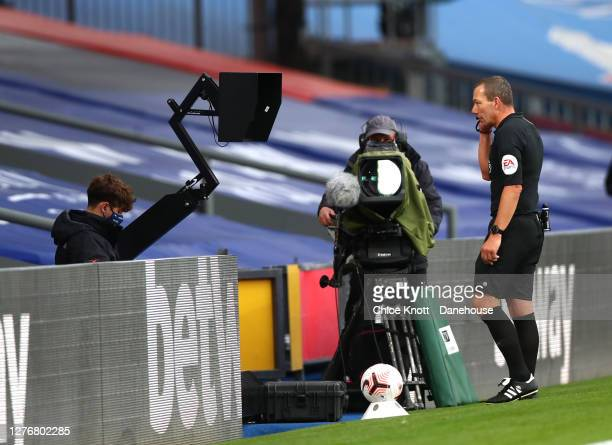 Referee Kevin Freind checks the VAR display before awarding Everton a penalty for a handball during the Premier League match between Crystal Palace...