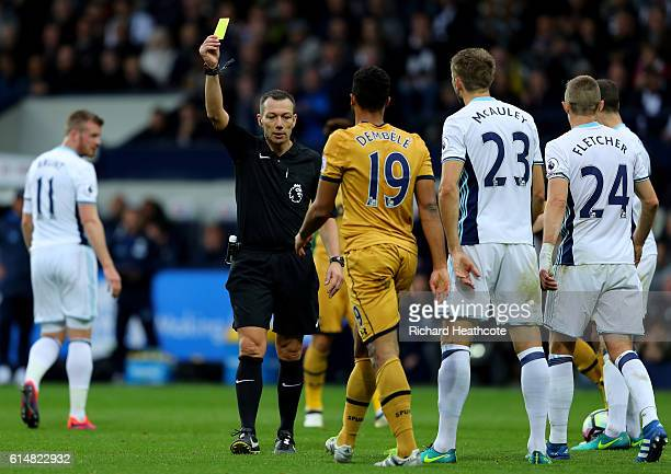 Referee Kevin Freind gives Mousa Dembele of Tottenham Hotspur a yellow card for diving during the Premier League match between West Bromwich Albion...