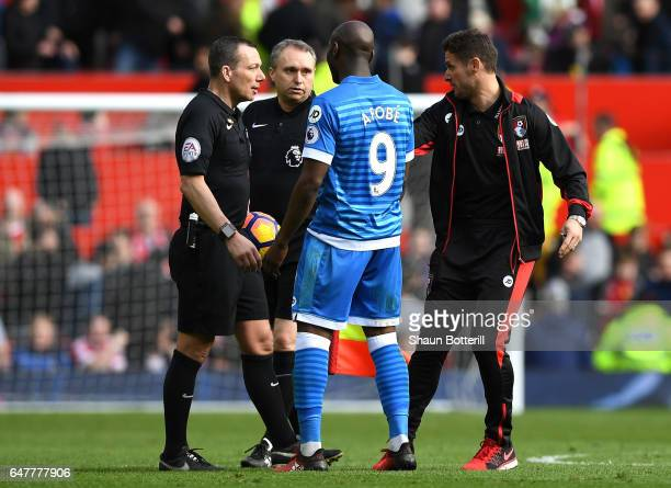 Referee Kevin Friend Benik Afobe of AFC Bournemouth and Jason Tindall AFC Bournemouth assistant manager argue at half time during the Premier League...