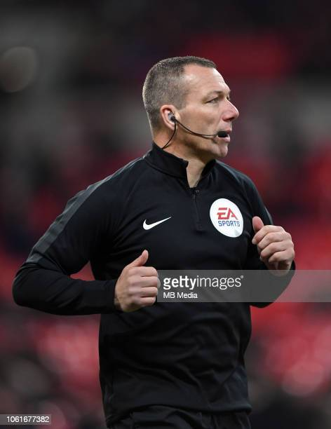Referee Kevin Friend during the pre-match warm-up before the Premier League match between Tottenham Hotspur and Manchester City at Wembley Stadium on...