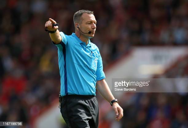 Referee Kevin Friend gestures during the Premier League match between AFC Bournemouth and Sheffield United at Vitality Stadium on August 10, 2019 in...