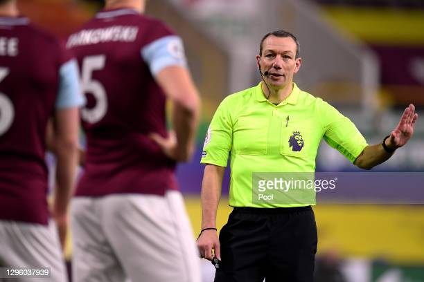 Referee Kevin Friend gestures during the Premier League match between Burnley and Manchester United at Turf Moor on January 12, 2021 in Burnley,...