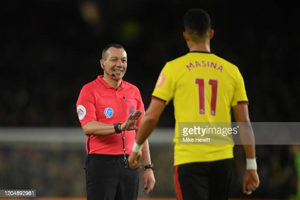 Referee Kevin Friend has a friendly word with Adam Masina of Watford during the Premier League match between Brighton & Hove Albion and Watford FC at...
