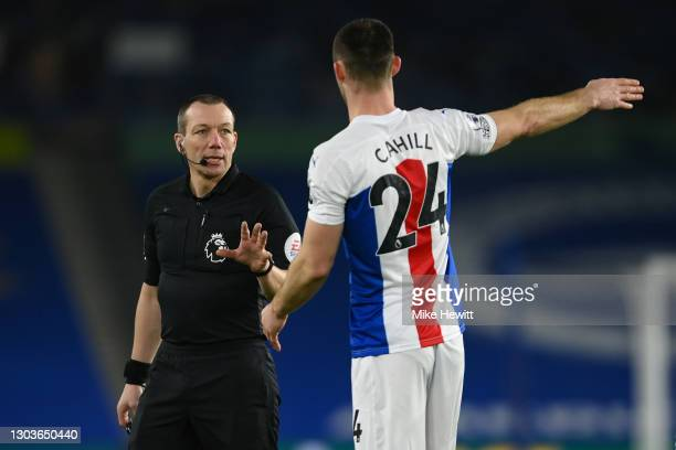 Referee Kevin Friend has a word with Gary Cahill of Crystal Palace during the Premier League match between Brighton & Hove Albion and Crystal Palace...