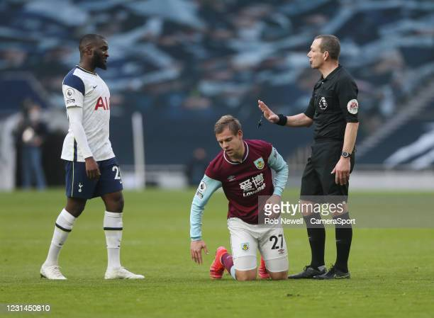 Referee Kevin Friend has words with Tottenham Hotspur's Tanguy NDombele after Burnley's Matej Vydra had been fouled during the Premier League match...