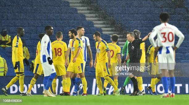 Referee Kevin Friend shows a red card to Brighton's Irish defender Shane Duffy during the English Premier League football match between Brighton and...