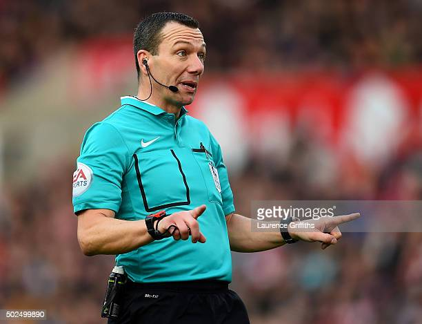 Referee Kevin Friend signals during the Barclays Premier League match between Stoke City and Manchester United at Britannia Stadium on December 26...