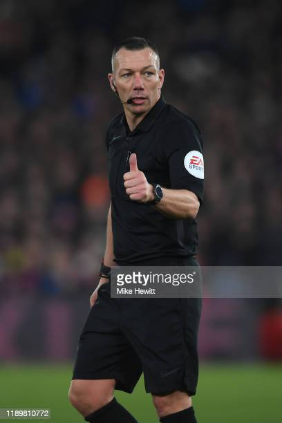 Referee Kevin Friend signals during the Premier League match between Crystal Palace and Liverpool FC at Selhurst Park on November 23 2019 in London...