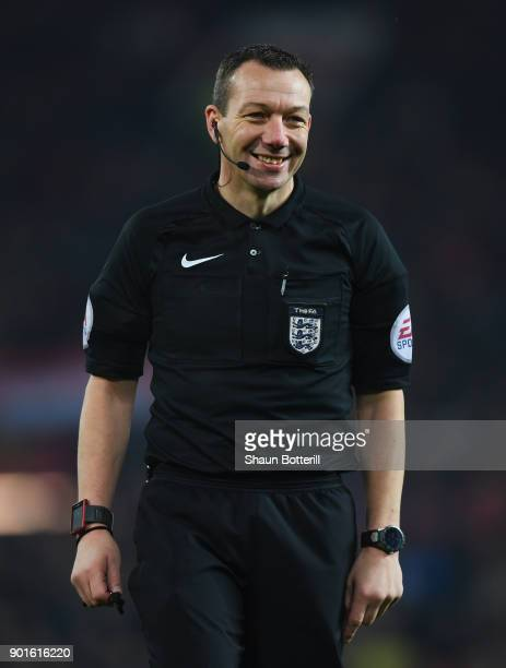 Referee Kevin Friend smiles during the Emirates FA Cup Third Round match between Manchester United and Derby County at Old Trafford on January 5,...